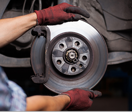 Auto Mechanic at Hectors Auto Repair repairing engine